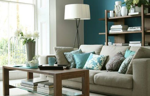 Soft, understated elegance. The teal accent wall helps ground this taupe-grey color