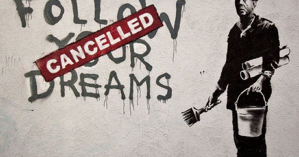 This graffiti by banksy explores the idea of our dreams being dictated