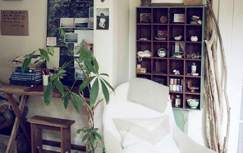 Love this apartment on Designsponge. Great magazine storage idea!