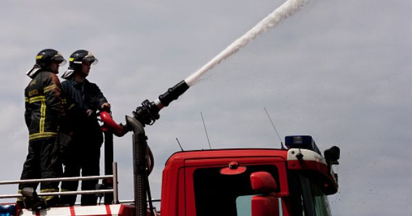 Fire Fighters Using Hose On Truck Firefighter Pictures Firefighter Fighter