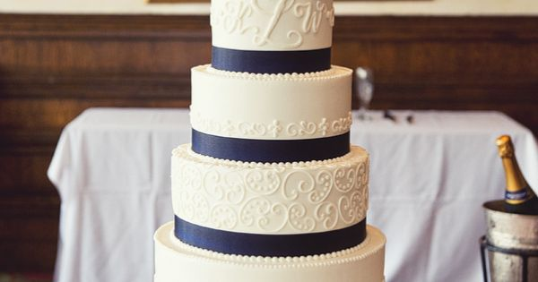 Wedding Cake With Coral Flowers and Navy Blue Ribbon! But with pink