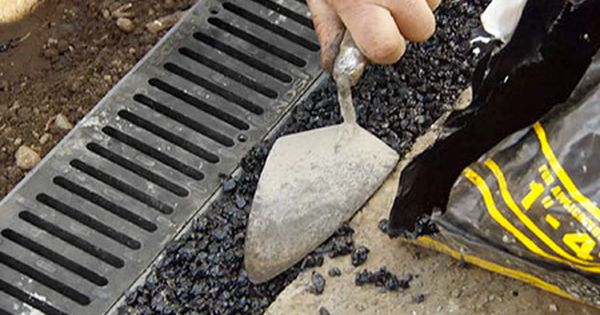 How To Install A Channel Drain Yard Drainage Drainage Solutions Backyard Drainage