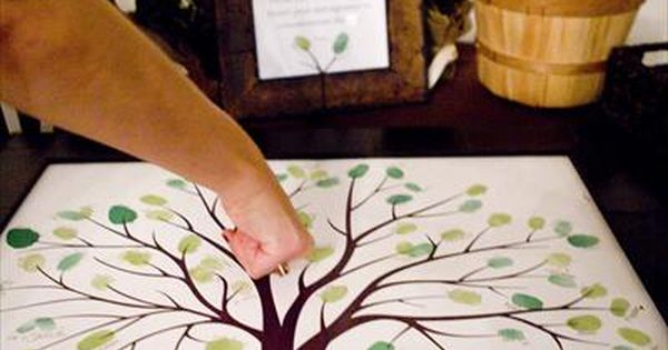 What an awesome idea! Guests leave their thumb print as the leaves