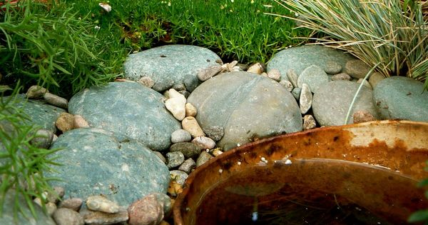 fairy garden- stones around fountain