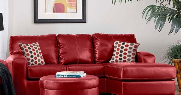 Living room with red leather sectional sofa set and round matching
