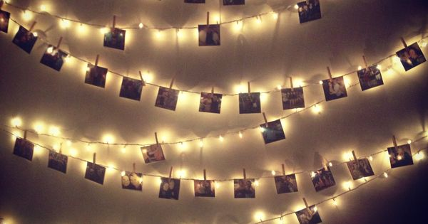 white christmas lights strung along the wall - pictures pinned up with clothes pins crafts ...