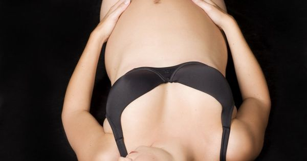 maternity photo, photo idea. interesting angle. simple black background.
