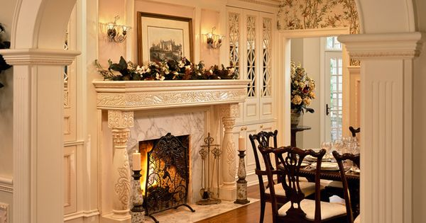 Traditional dining room chairs built ins on sides of for Traditional dining room fireplace