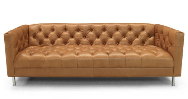 baxter sofa All-over button tufting and solid aluminum legs make this streamlined