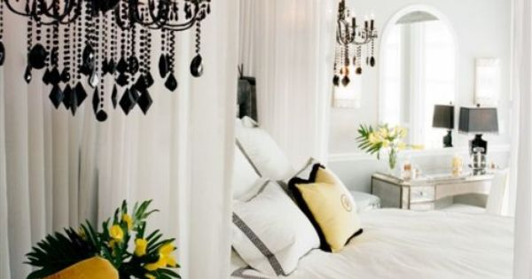 bedroom // canopy, yellow chair, black chandelier