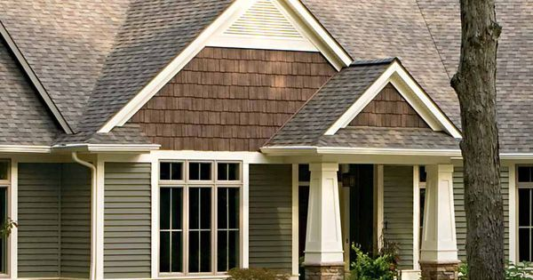 The Textures Of The Rock Siding And Shingles Make This A