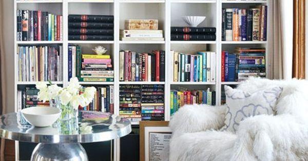 ahhh....fur chair, built in book shelves, library idea