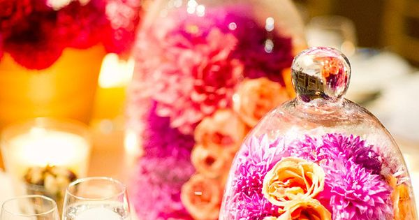 gorgeous colorful floral centerpieces in glass bell jars