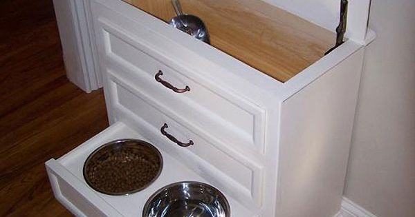 LOVE this idea!! Made from small dresser. Pet food is kept in
