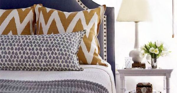 love this slate blue headboard, mustard yellow chevron pillow, and pale gray