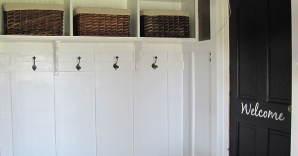 mudroom in garage...love the welcome on the door. I'd like to have