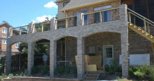 Like The Combination Of Stone Columns With Wood And Iron Rails Stone Deck House Deck Flagstone Patio