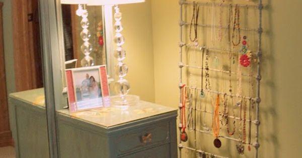 Baby crib rail as jewelry organizer.