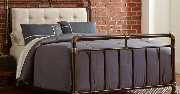 A Sturdy Iron Headboard And Footboard Softened With Tufted