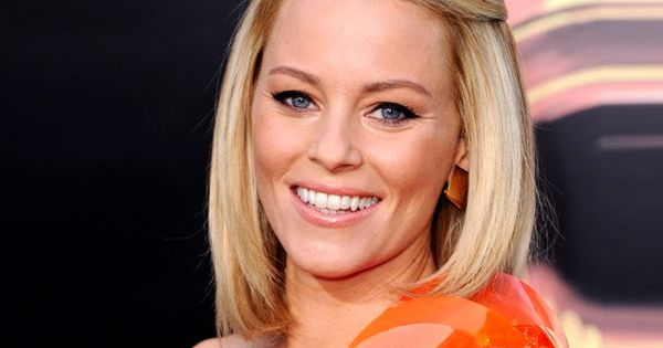 love the subtle 60s hair and make up, but love Elizabeth Banks'