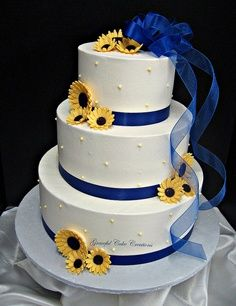 Elegant White Buttercream Wedding Cake With Royal Blue Ribbon And