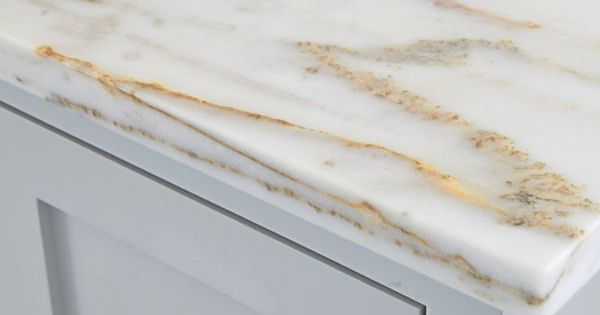 Marble Countertops With Specks Of Gold Mesh Beautifully