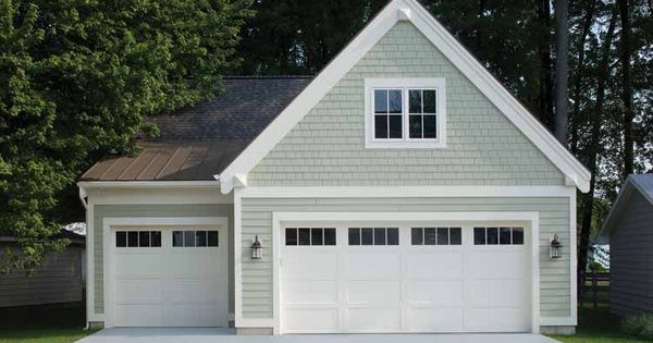 White carriage house style garage doors on a detached for Low country house plans with detached garage