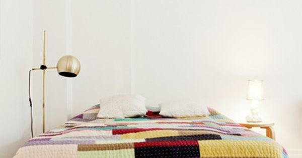 I like the idea of plain walls with rugs, blankets, and accessories