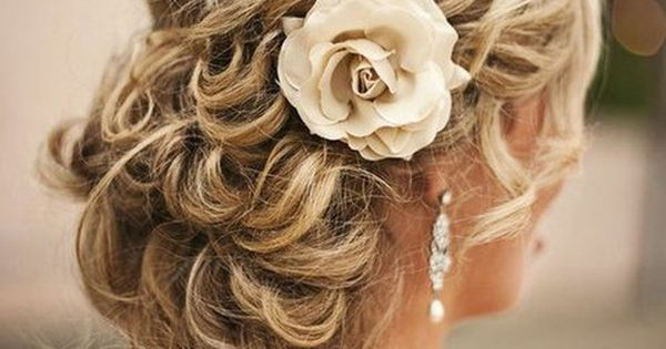 wedding bridal hair style tip; add silk flower to finish relaxed curls