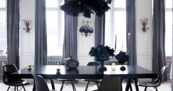 Stunning dining room with white walls, black furniture, charcoal ...