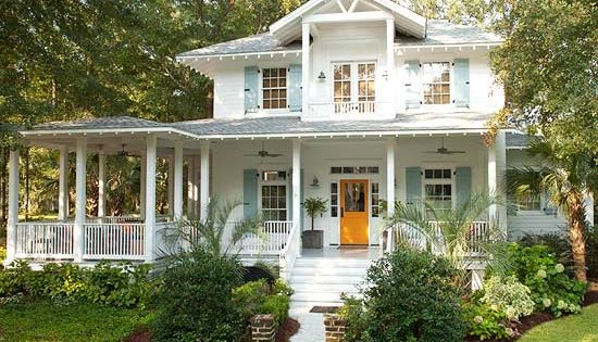 Dream house. Contemporary Cottage with bright white paint, blue-gray shutters, and a