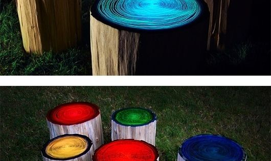 log stools painted with glow in the dark paint for our firepit