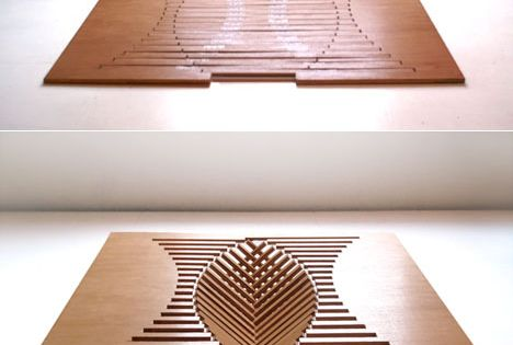 "Folding table designed by Robert van Embricq for his ""Rising"" series"