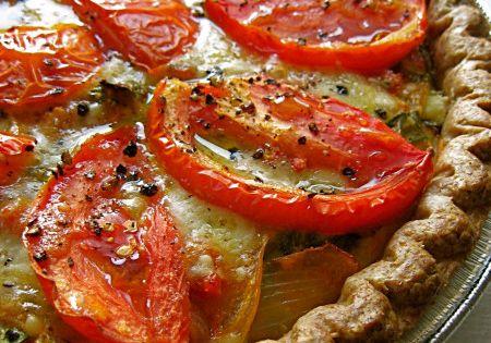 Julia Child's Provencal tomato quiche with kalamata olives, garlic, and parmesan....