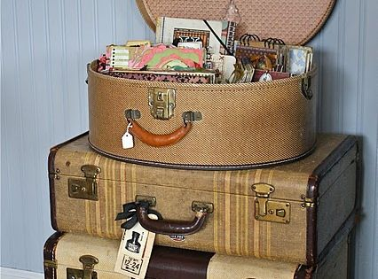 Vintage suitcase display used as a dresser