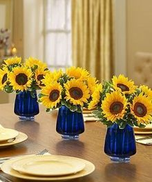 Beautiful Royal Blue And Sunflower Mason Jar Centerpieces For A