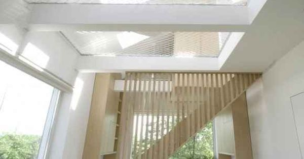 Indoor hammock - Have an extra-tall ceiling? Stretch a ceiling hammock across