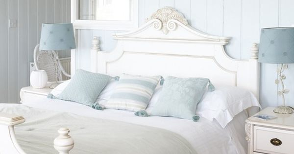 White-painted furniture looks great against pale blue walls in this fresh and