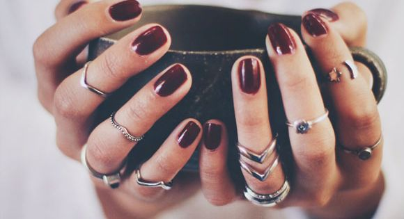 midi rings and burgundy nail polish