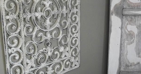 "Dollar store outdoor black rubber door mat /spray paint= ""ironwork"" wallart"