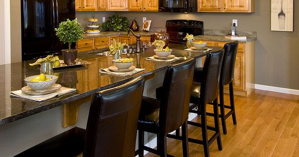 Model Kitchen With Oak Cabinets Like The Paint Color