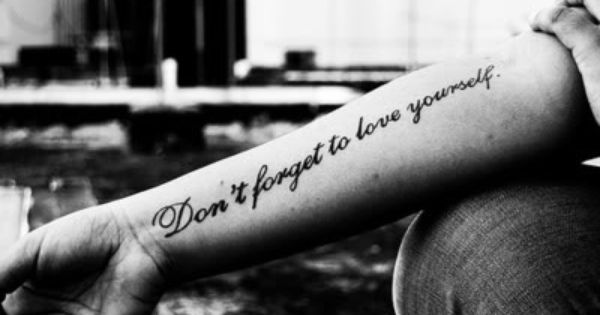 """Don't forget to love yourself"" Quote Tattoo on the arm"