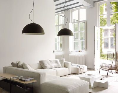 Living room, round lamps, white couches, rug, open windows, light