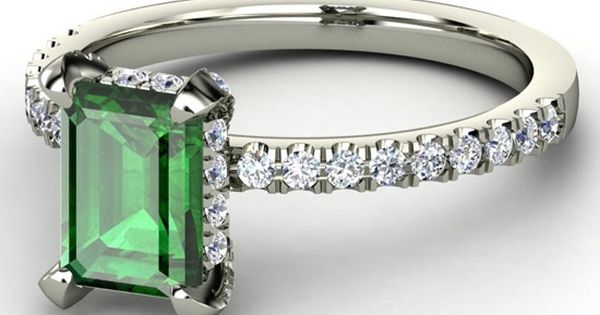 Emerald cut emerald, non traditional stone in classic style. Don't usually see