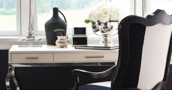 chic black and white office with French chair, zebra rug, chrome table,