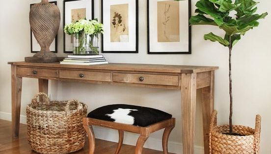Foyer Table With Stools : Chic foyer features a seagrass basket and cowhide stool