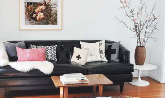 I normally shy away from black leather sofas (too 90s?) but this