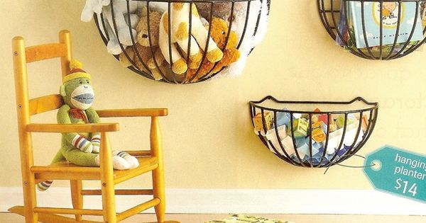 garden planters used as wall storage for kids' toys