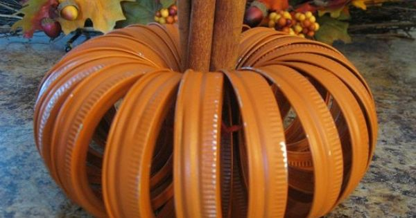 Fall craft: Spray canning lids orange, tie together, insert some cinnamon sticks