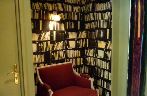Reading nook at l'Hotel du Petit Moulin, designed by Christian Lacroix books